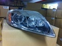 Original and New Headlight for Audi Q7